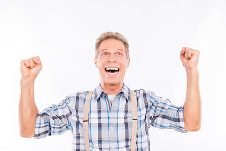 put up: Handsome excited man put up his hands