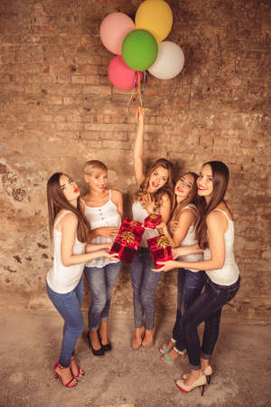 unexpectedness: Portrait of cute girls having cool party Stock Photo