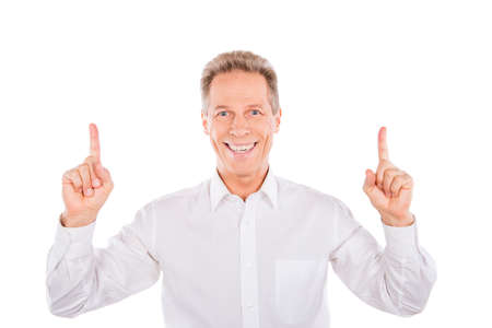happy people white background: A mature smiling man  taking pointer fingers up