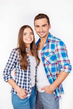 amigos abrazandose: Portrait of cute young couple in checked shirts Foto de archivo