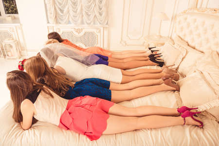 hen party: Cute girls have a hen party and lying on bed Stock Photo