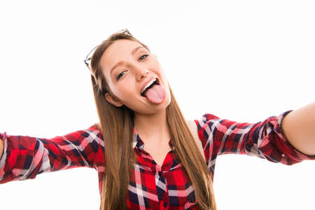protruding eyes: Portrait of funny girl grimacing and making selfie