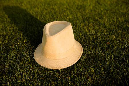 girlish: cream girlish hat on the green grass