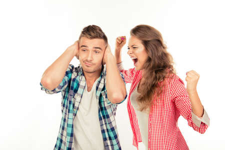 scream: Calm young man ignore his angry girlfriend