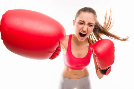 female boxing: Beautiful angry sportswoman in red boxing gloves