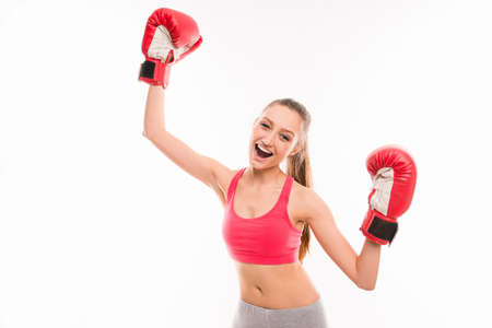 female boxing: Positive sporty girl in boxing gloves triumphing