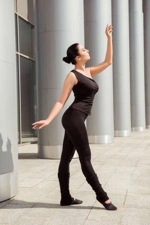graceful: Slender graceful ballerina dancing at the building Stock Photo