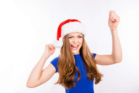 newyears: Party girl dances in red New-Years hat Stock Photo
