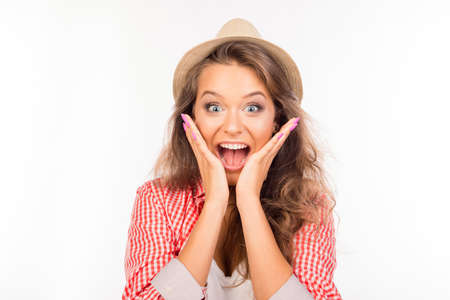 Happy young surprised woman with hat