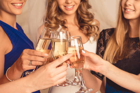 Closeup photo of cheerful girls celebrating a bachelorette party