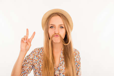 comically: Funny girl joking and showing peace sign Stock Photo