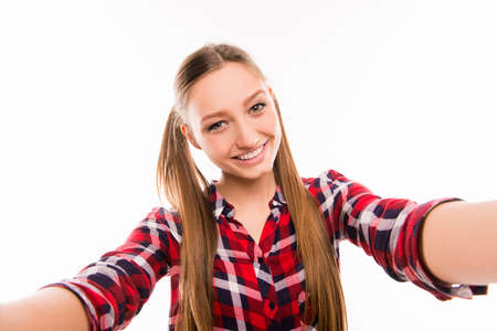 bunches: Portrait of funny girl making selfie photo