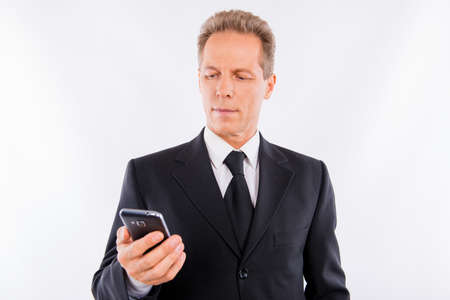 A handsome mature businessman with modern mobile phone