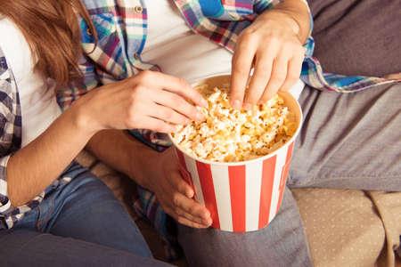 movie popcorn: young woman and man in tartan shirt eating popcorn Stock Photo