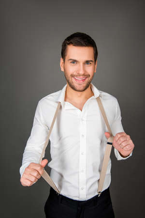 suspenders: Sexy smiling man with suspenders Stock Photo