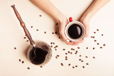 cezve: Cup of coffee, coffee beans and cezve, top view photo
