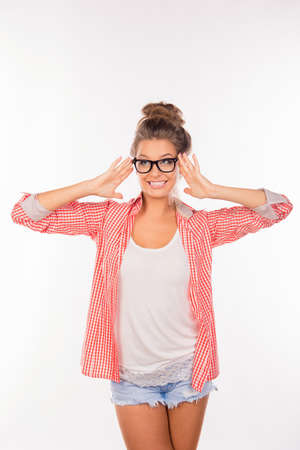 funny glasses: Cheerful girl in glasses with funny hairstyle