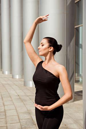 ballerina girl: Elegant ballerina dancing in the street