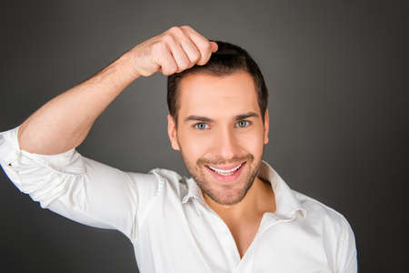 hairdress: Smiling young man making a hairdress