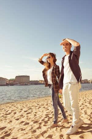 looking ahead: Couple in love looking ahead on the beach