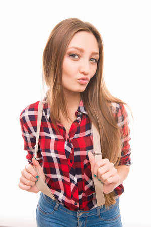portarit: Portarit of happy young girl with suspenders pouting her lips Stock Photo