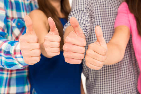 team ideas: Closeup photo of a group showing thumbs up Stock Photo