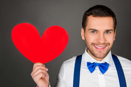 pf: Close up photo pf handsome man with red paper heart