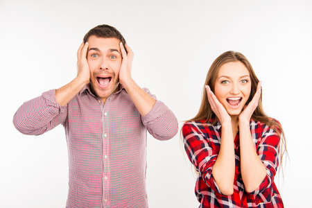 Pretty funny cheerful couple showing surprise Stock Photo - 51505271