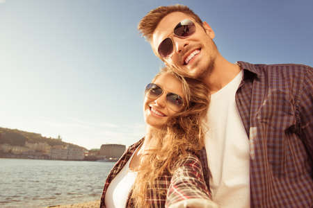 Selfie photo of young couple in love near the river Stock Photo
