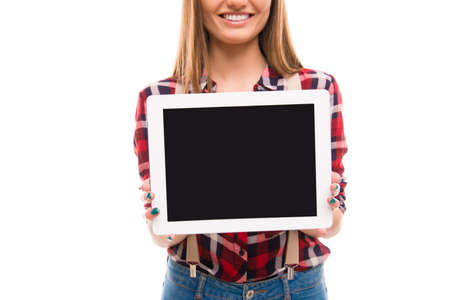 reredos: Cheerful girl showing screen of tablet