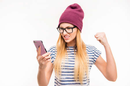 furor: Angry frustrated young woman with phone Stock Photo