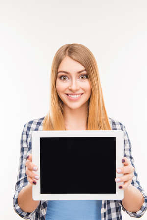 reredos: Pretty young girl showing screen of tablet