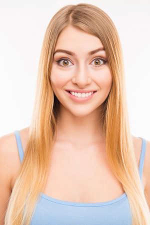 beaming: Close up portrait of young pretty girl with beaming smile Stock Photo