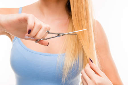 split ends: Woman cut her hair. Problem of split ends