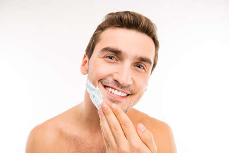 smearing: Handsome young man smearing shaving foam on his chin Stock Photo