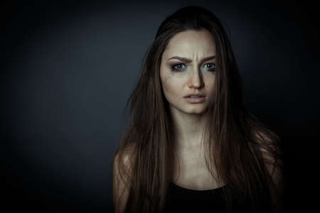 disheveled: Close up portrait of a sad woman, hair disheveled. Stock Photo