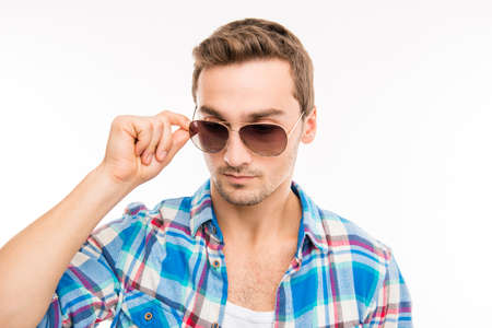 minded: Minded man holding his spectacles Stock Photo