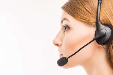 caller: A close-up side-face portrait of a young agent of call centre
