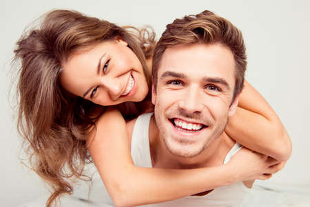sex pose: Happy cute girl in love at home embracing boyfriend Stock Photo