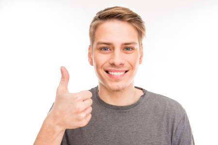"""Pretty cheerful young man in gray T-shirt gesturing """"LIKE"""""""