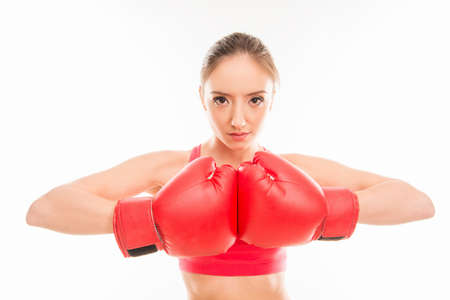 sportswoman: Portrait of young sportswoman in red boxing gloves Stock Photo