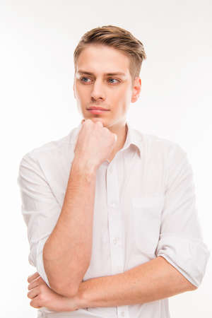 minded: Young handsome minded businessman touching his chin Stock Photo
