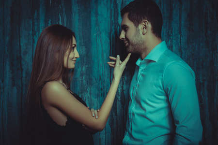 Beautiful elegant girl flirts with a handsome man