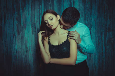 young couple kiss: Portrait of man kissing her girlfriend in neck Stock Photo