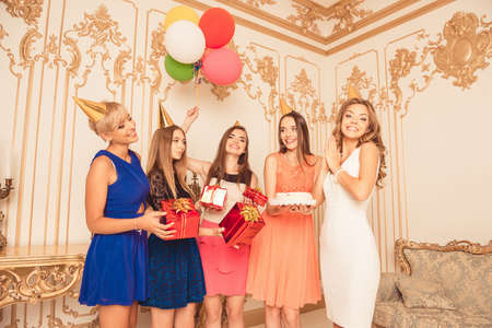 girl party: Company of cute girls celebrating birthday party