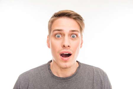 Portrait of surprised handsome man in gray T-shirt Zdjęcie Seryjne