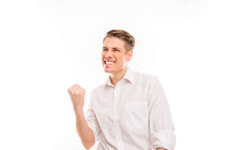 triumphing: Happy young man triumphing with raised hand