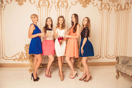 bridesmaids: Pretty bride with bridesmaids celebrating hen-party Stock Photo