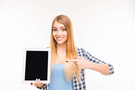 reredos: Pretty young girl pointing on screen of tablet Stock Photo