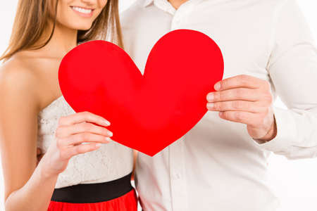 couples in love: Couple in love holding big paper heart